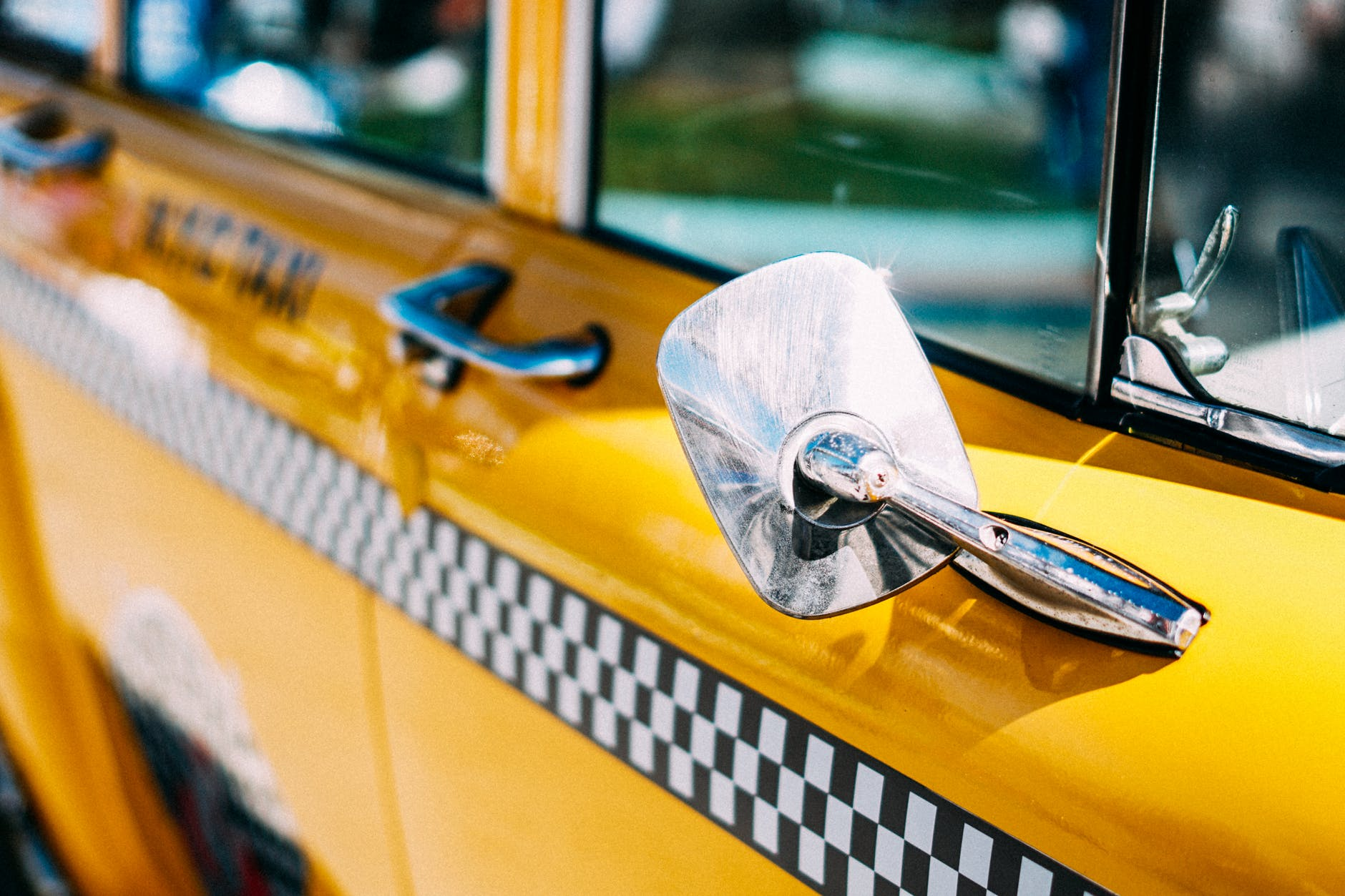 closeup photo of yellow taxi
